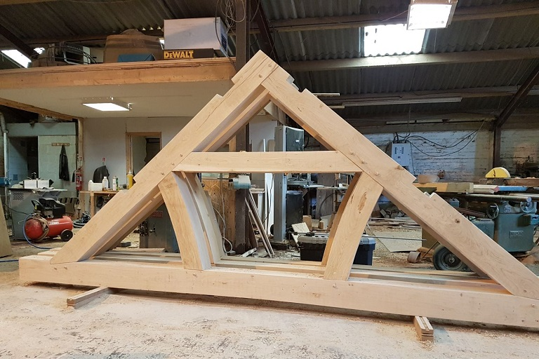 Boxed curve tied queen roof truss in douglas fir
